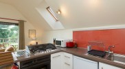 fully appointed kitchen in open plan living space